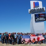 Group of employees in front of Jor-Mac sign