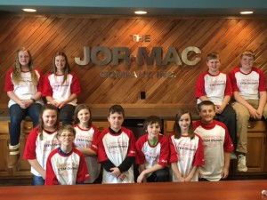 Students in front of Jor-Mac Logo